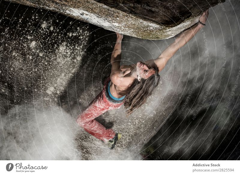 A man climbing on the rock from magnesium, mountain at dusk. Creativity Human being Chalk Climbing Strong Athletic decisions Energy Fingers Stone block Action