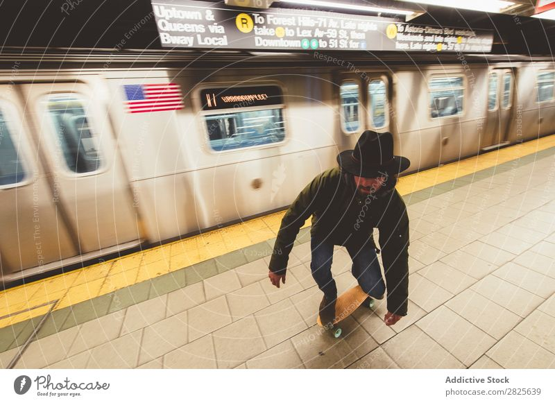 Man on skateboard in subway riding Underground Skateboard Copy Space Cool (slang) Self-confident Hat bearded Earnest Brutal Beard Human being City Hipster