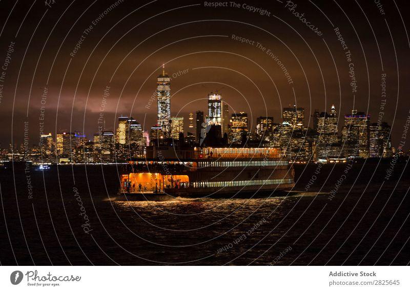 Ferry on the background of city Watercraft Sail Skyline nyc Night Manhattan City Town america Architecture High-rise Building Evening Light Landmark Twilight