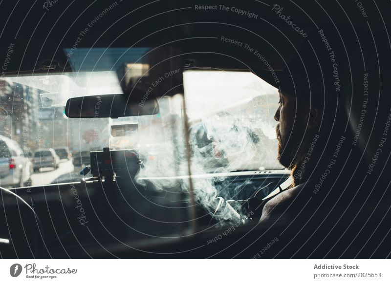 Man sitting in the car Smoking Taxi Vehicle Hat bearded Cigarette Self-confident Earnest Street Brutal Beard Human being City Hipster Adults Easygoing Lifestyle