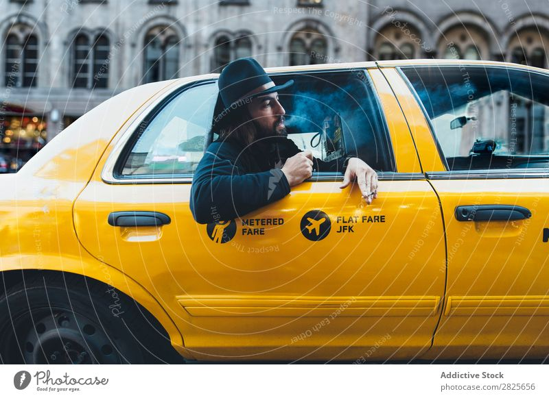 Smoking man looking out of taxi Man Ride Taxi Vehicle Hat bearded Cigarette Self-confident Earnest Street Brutal Beard Human being City Hipster Adults Easygoing