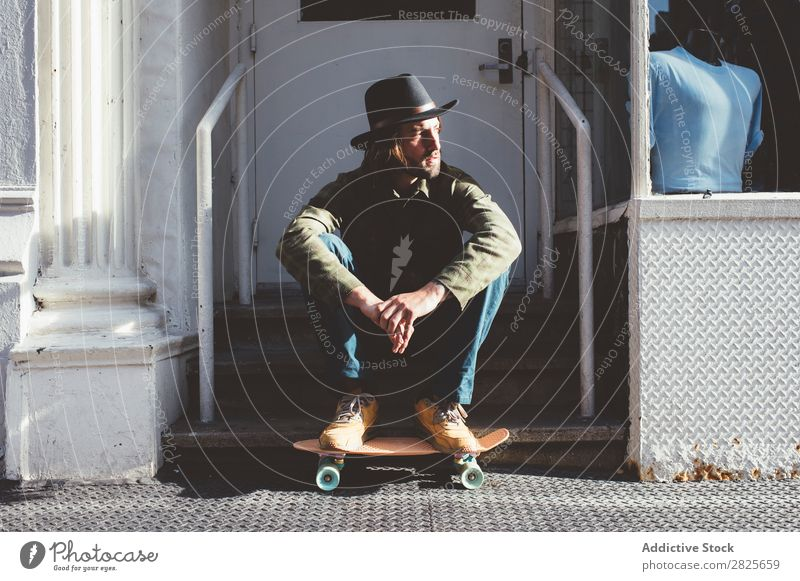 Cool man sitting at stairs Cool (slang) Man Skateboard Sit Stairs Self-confident Hat bearded Earnest Street Brutal Beard Human being City Hipster Adults