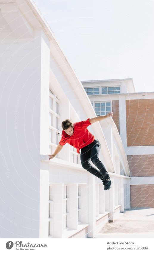 Man jumping on roof sportsman Parkour Roof tracer Climbing Relaxation physical Risk rooftop motivation Action Runner Town Stunt Extreme adrenaline workout