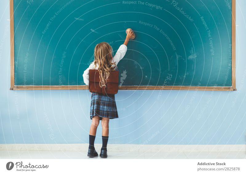 Pupil writing on the blackboard Girl Classroom Blackboard Stand Cheerful Happy Book Chalk