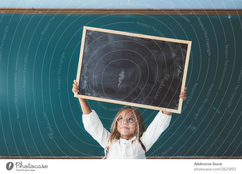 Happy girl standing with chalkboard Girl Classroom Blackboard Stand Hold Scream Cheerful