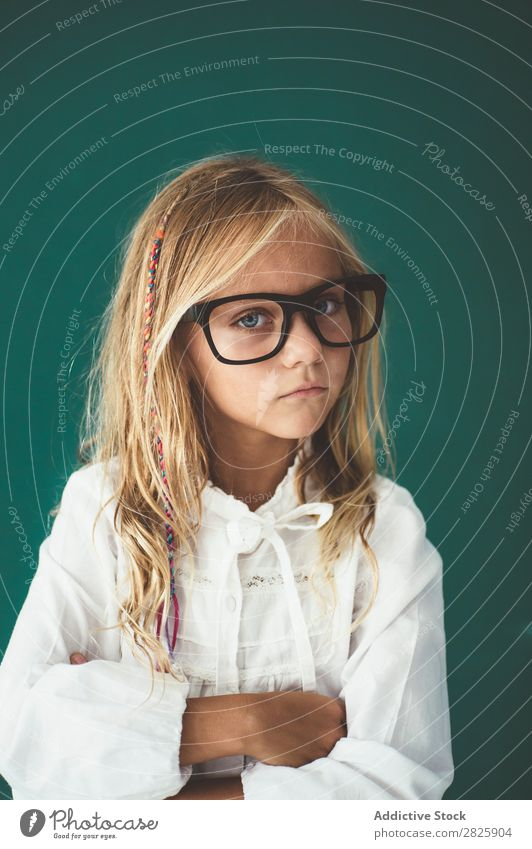 Cute schoolgirl posing in a classroom Girl Classroom Blackboard Person wearing glasses Cheerful Stand Education