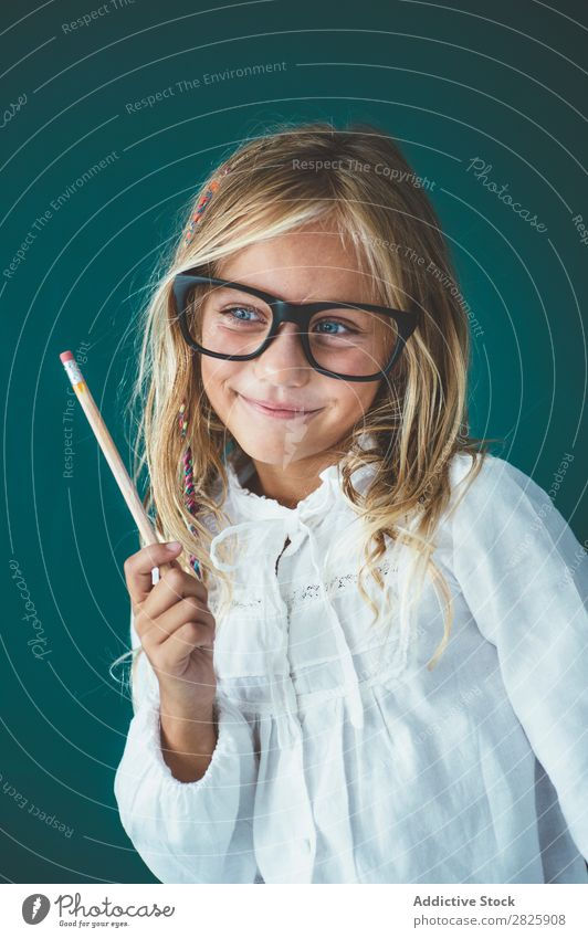 Cute schoolgirl with pencil Girl Classroom Blackboard Person wearing glasses Pencil Smiling Cheerful Stand