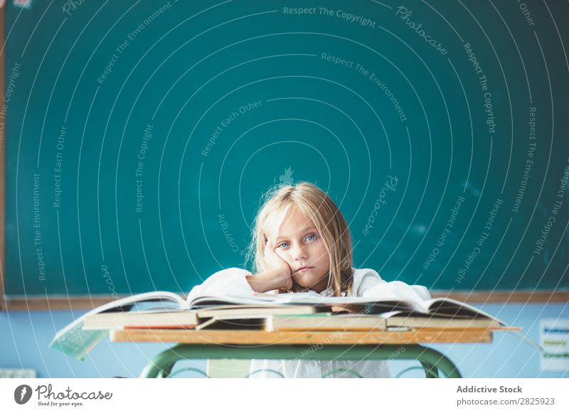 Bored girl in classroom Girl Classroom Blackboard Sit Desk Looking into the camera Dull Dream
