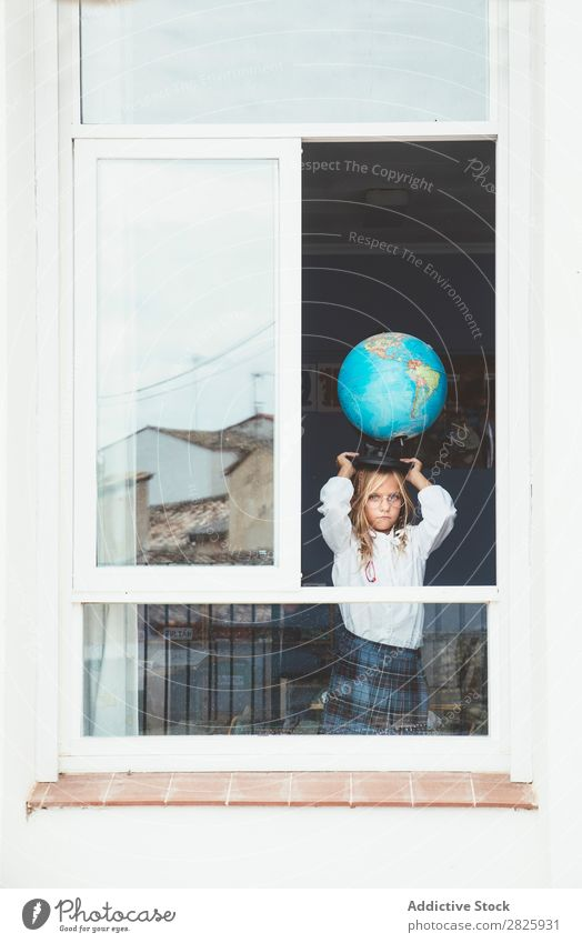 Schoolgirl posing with globe Girl Classroom Globe Window Map Posture Stand Cute