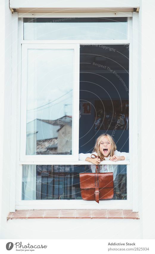 Schoolgirl posing with backpack in a window Girl Classroom Window Posture Stand Cute Education Grade (school level) Student Youth (Young adults) Study Child
