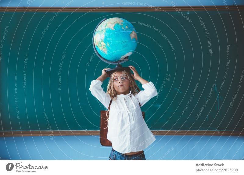Pupil girl posing with globe Girl Classroom Globe Geography Cute Education School Grade (school level)