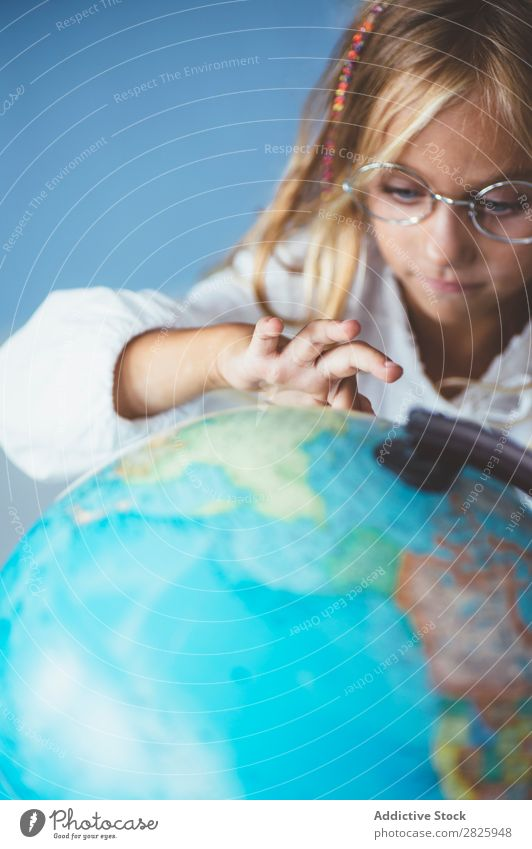 Pupil girl pointing at globe Girl Classroom Sit Globe Geography Indicate Cute Education