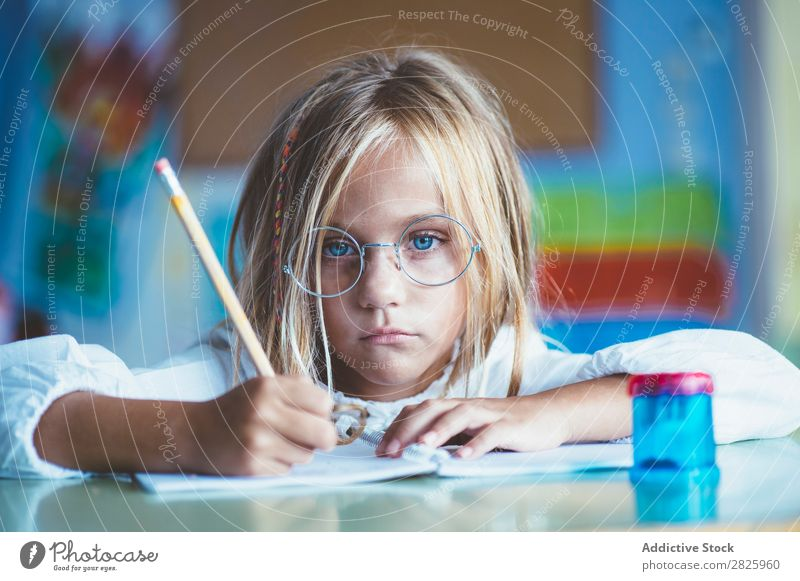 Thoughtful girl writing in class Girl Classroom Sit Desk Writing Pencil Drawing Think