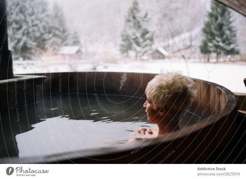 Blonde woman swimming in outside plunge tub Woman Swimming Nature Winter Water Healthy Beautiful Vacation & Travel Romania Float in the water Snow Ice Natural