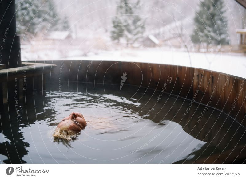 Woman relaxing in plunge tub Swimming Nature Winter Water Healthy Beautiful Vacation & Travel Romania Float in the water Snow Blonde Ice Natural Human being Wet