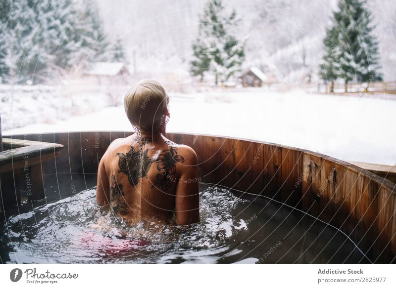 Woman swimming in outside tub Swimming Nature Winter plunge tub Water Healthy Beautiful Vacation & Travel Romania Float in the water Snow Ice Natural