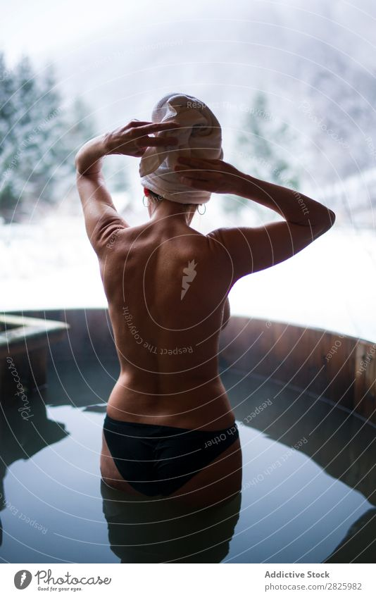 Naked woman standing in plunge tub Woman Swimming Nature Winter Water Healthy Beautiful Vacation & Travel Romania Float in the water topless Stand Snow Ice