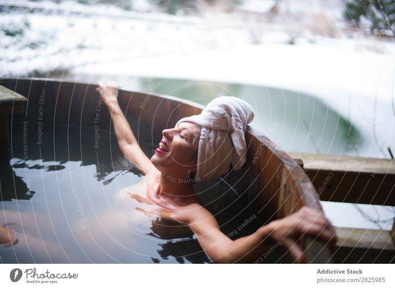 Cheerful topless woman in plunge tub Woman Swimming Nature Winter Lie (Untruth) Relaxation eyes closed Water Healthy Beautiful Vacation & Travel Romania