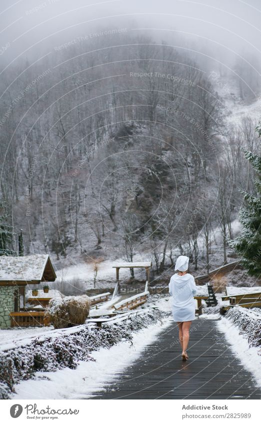 Woman in bathrobe walking to forest Nature Winter Walking Forest boardwalk Corridor Healthy Beautiful Vacation & Travel Romania Snow Bathrobe Ice Natural