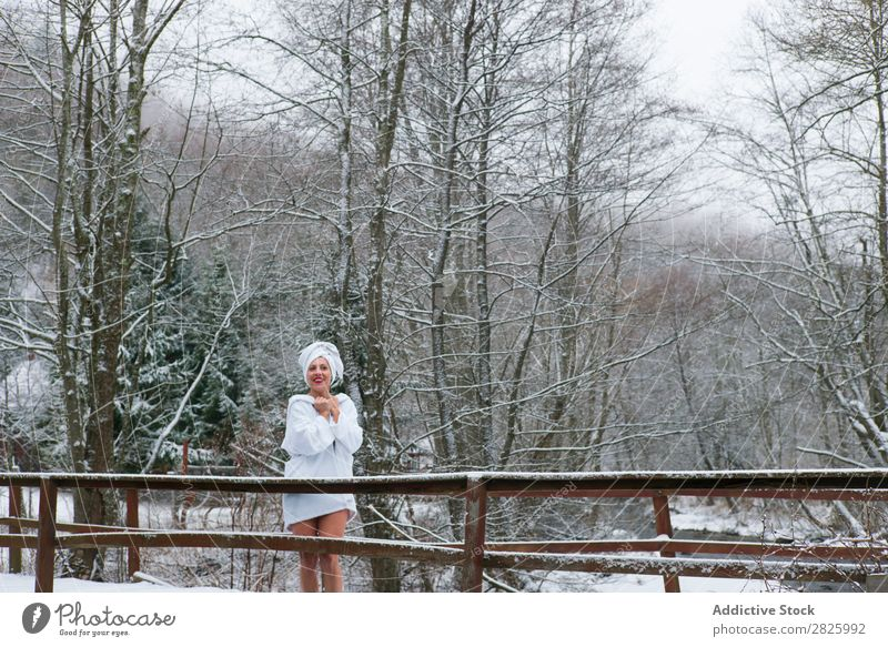 Cheerful woman in towel at river Woman Nature Winter Forest Healthy Bathrobe undressing Happy Towel Beautiful Vacation & Travel Romania Snow Ice Natural
