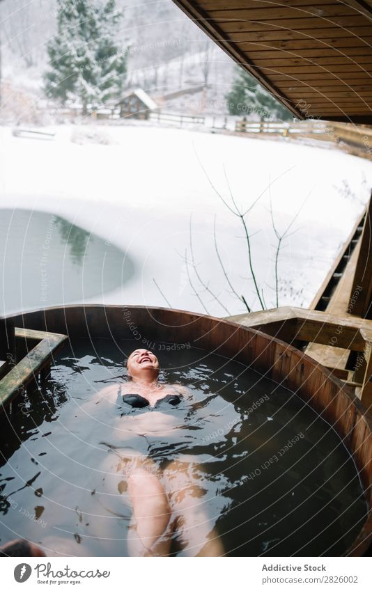 Cheerful woman in outside plunge tub Woman Swimming Nature Winter Water Healthy Beautiful Vacation & Travel Romania Float in the water Snow Ice Natural