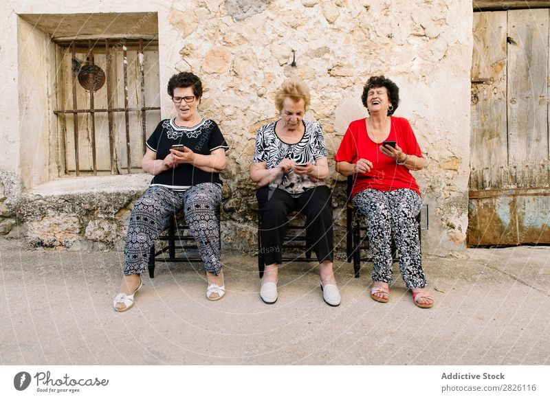 Three women of age advanced with smartphone Old Human being Telephone New Interlaced Lifestyle Mature Mobile Modern retired Retirement Touch Technology using