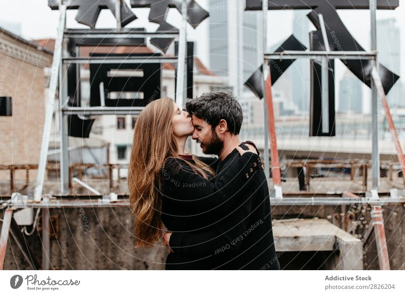 Male and female embrace on rooftop Couple Embrace City Love Vantage point Kissing Happy romantic Together Beautiful Youth (Young adults) Man Woman Romance