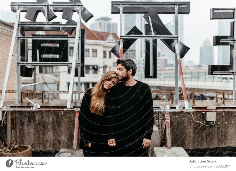 Happy couple on rooftop Couple Embrace City Love Vantage point Kissing