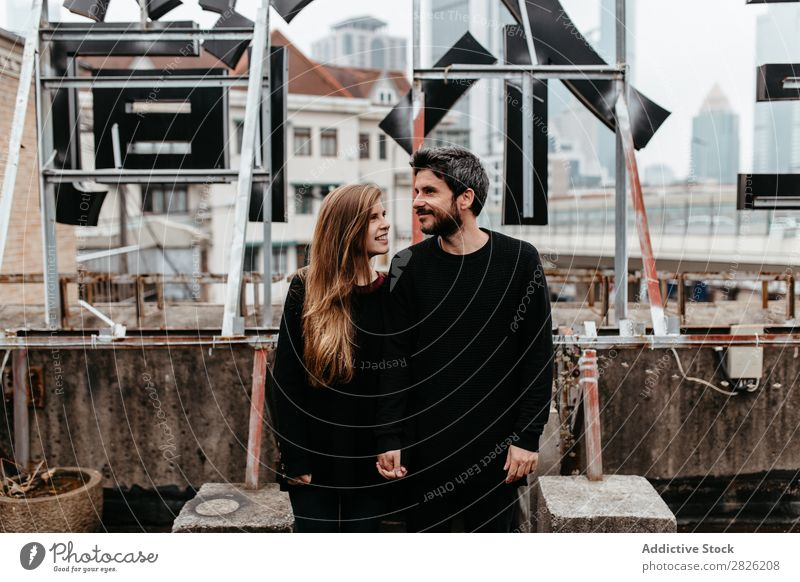 Happy couple on rooftop Couple Embrace City Love Vantage point Kissing romantic Together Beautiful Youth (Young adults) Man Woman Romance Relationship Happiness