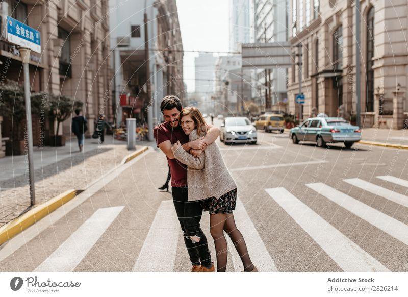 Beautiful couple hugging on crosswalk Couple Embrace Street City Walking Together Happy Lifestyle Man Girl Woman Town Pedestrian Pedestrian crossing