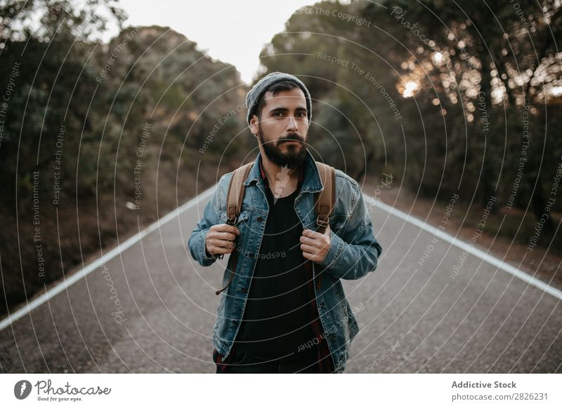 A tourist on a road Man Tourist Backpack Street Tourism Vacation & Travel Adventure Youth (Young adults) Trip backpacker traveler Nature Stand
