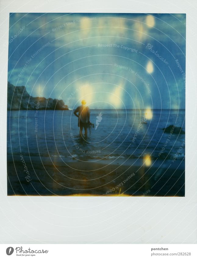Older man stands ankle-deep in the sea. Vacation and recreation. Crete. Polaroid Man Adults 1 Human being Nature Beautiful weather Beach Ocean Stand Blue Rock