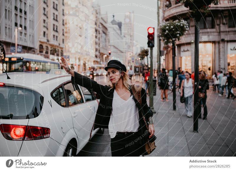 Woman taking taxi in city Taxi Take Street City Youth (Young adults) Lifestyle Vacation & Travel Car Girl Human being Transport Tourist Beautiful Town Tourism