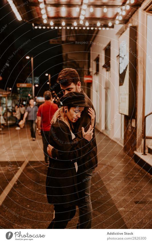 Couple embracing on evening street Evening Street Crowded Love Romance Beautiful Lifestyle