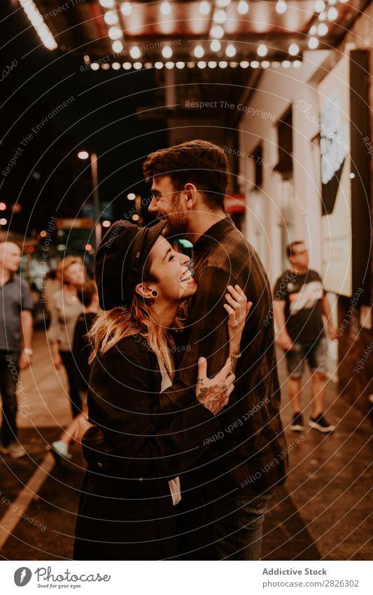 Couple embracing on evening street Evening Street Crowded Love romantic Romance Beautiful Lifestyle Man Woman Together City Lovers Light Illuminate 2