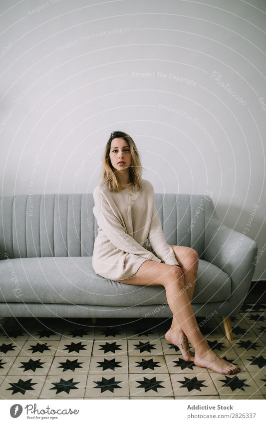 Woman sitting on couch Sit Sofa Portrait photograph Comfortable Couch Youth (Young adults) Home Pensive Considerate Attractive Beautiful Room Resting Easygoing