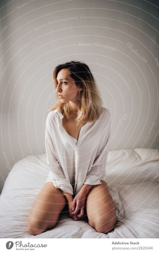 Woman sitting on a bed Bed Morning Looking away Home Attractive Beautiful Resting Lifestyle Human being Sit Bedroom Youth (Young adults) Posture Underwear White