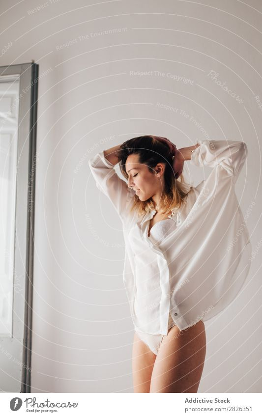Young woman stretching at home young sleepy morning lingerie white female beautiful lifestyle girl person pretty relax rest awake day energy leisure joy early