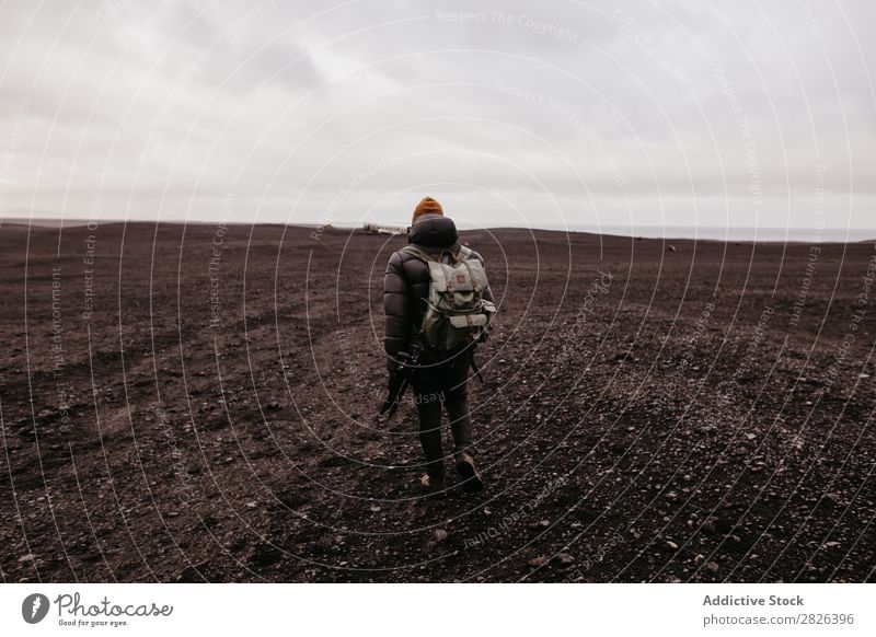 Tourist walking in desert Man Backpack Desert Iceland Nature Hiking Vacation & Travel Landscape Adventure Street Tourism Walking Volcanic scenery North