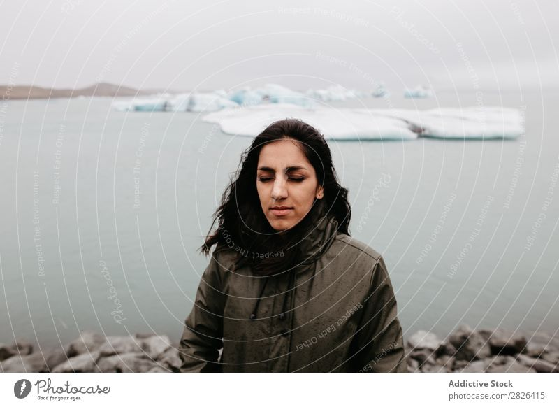 Woman on background of ice in ocean Ocean Glacier Nature Ice Landscape Vacation & Travel Tourism Iceland Environment Iceberg Winter White polar Water Posture