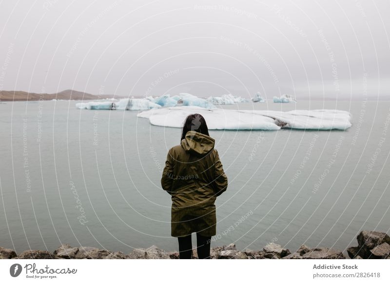 Anonymous woman looking at glacier Woman Ocean Glacier Nature Ice Landscape Vacation & Travel Tourism Iceland Environment Iceberg Winter White severe polar