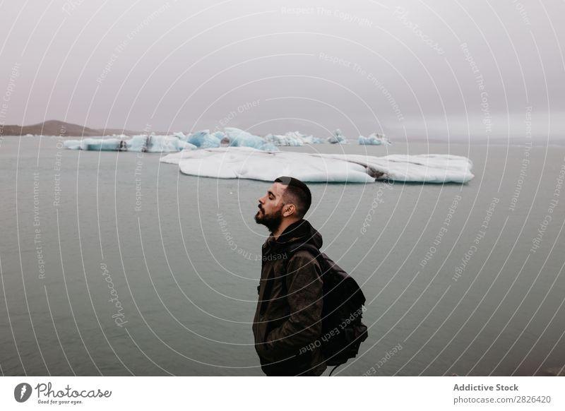 Bearded man at Jökulsárlón glacier Man Ocean Glacier Nature bearded Ice Landscape Vacation & Travel Tourism Iceland Environment Iceberg Winter White severe