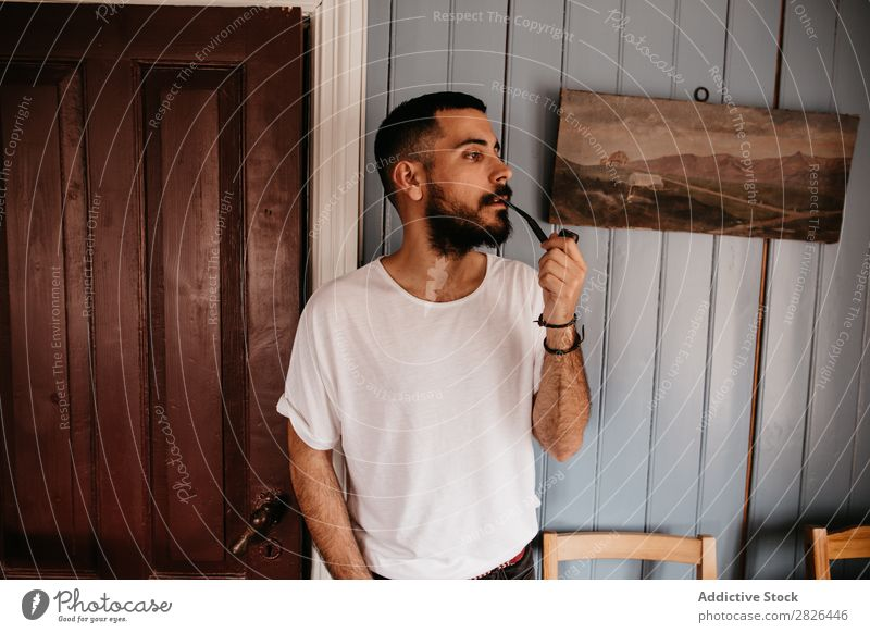 Man smoking pipe inside Pipe Hipster Style Adults House (Residential Structure) Iceland Tobacco Vintage Smoking bearded Posture Addiction Smoke Elegant