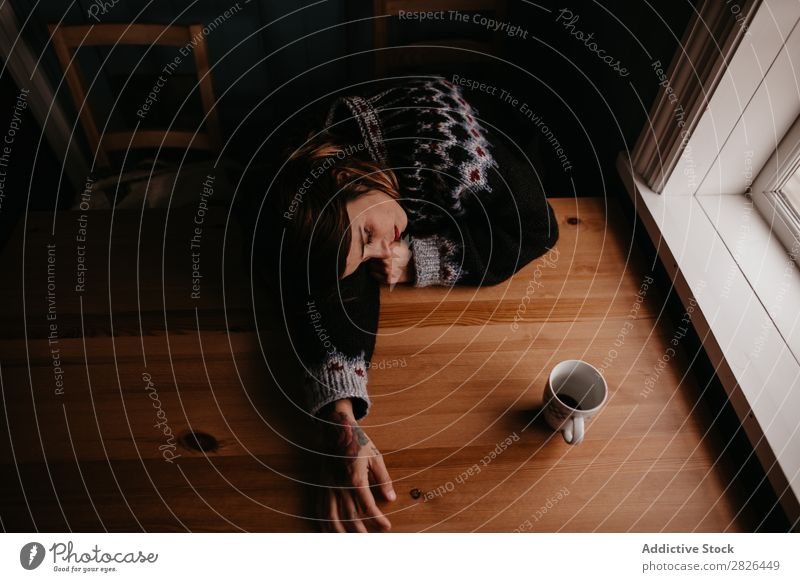 Woman lying on table with mug Table Sleep Iceland Home Morning exhausted Fatigue Dream asleep Stress Relaxation Interior shot Resting Mug Cup Refreshment