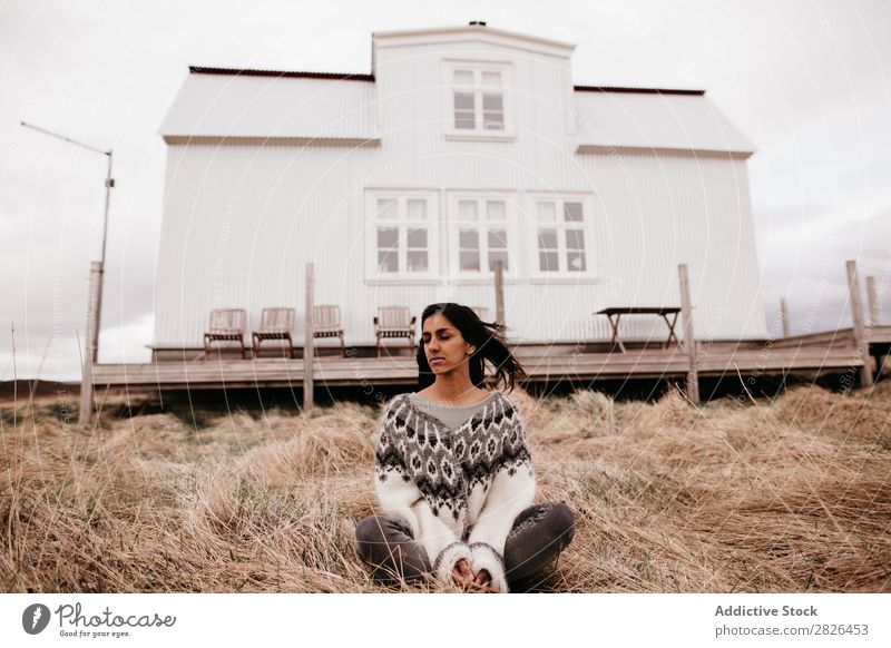 Woman posing on background of house House (Residential Structure) residential Iceland Nature Rural Terrace Home scenery Natural waving hair Landscape Plain Farm
