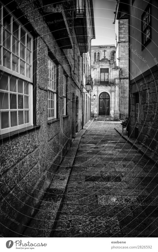 Old alley in the city Lamp Town Building Architecture Street Lanes & trails Stone Dirty Dark Retro Black Loneliness Dangerous Perspective City urban passage