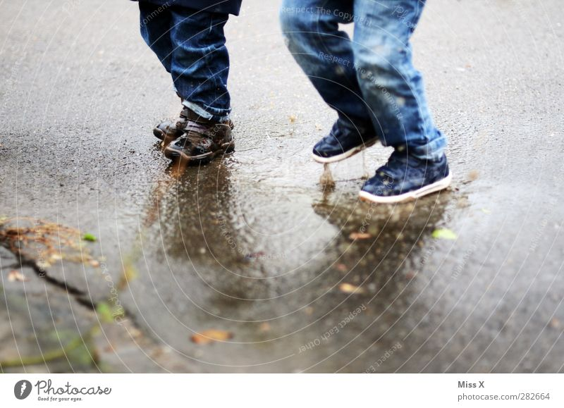 Human being Child Water Joy Cold Emotions Jump Legs Feet Infancy Dirty Wet Jeans Sidewalk Toddler Joie de vivre (Vitality)