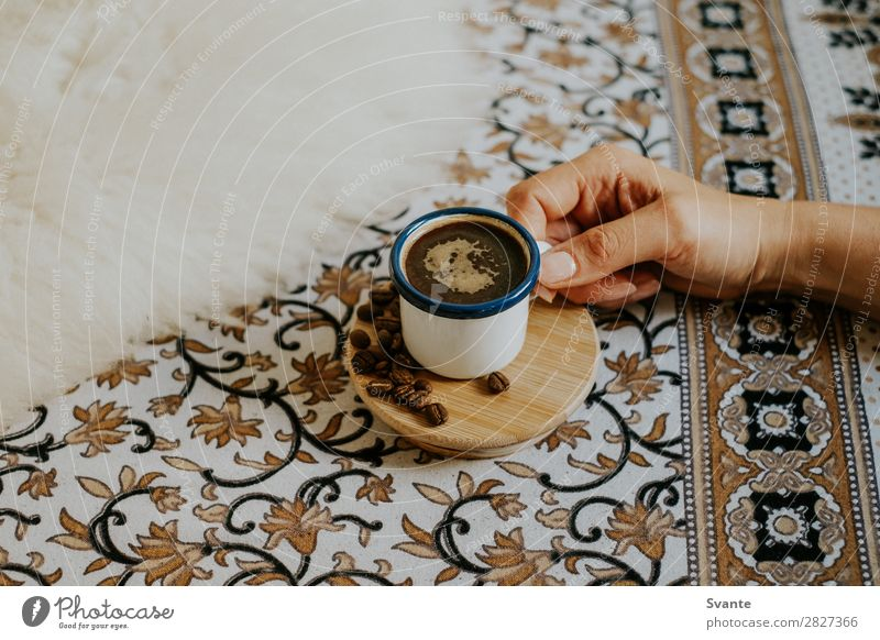 Woman holding espresso cup on floral pattern Human being Youth (Young adults) Young woman Hand Lifestyle Interior design Style Design Elegant Esthetic Coffee
