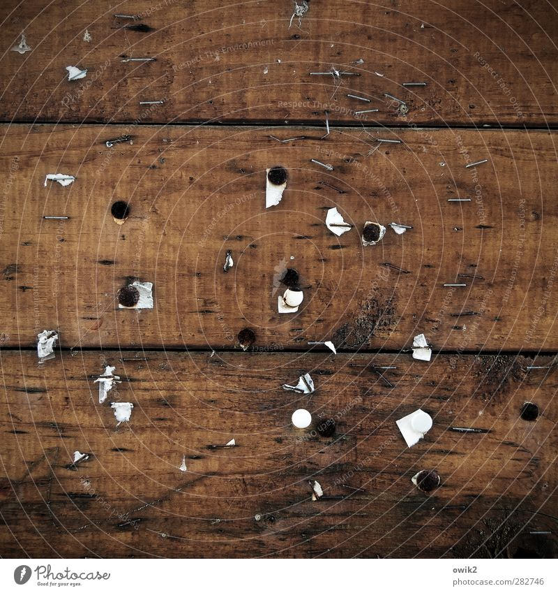 The latest of the day Wood Old Gloomy Brown Black White Wooden board Bulletin board Notice Thumbtack Colour photo Close-up Detail Abstract Pattern