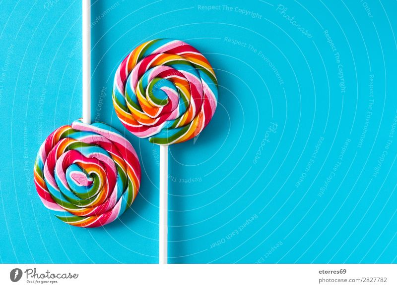 Colorful lollipops on blue background. Copyspace Lollipop Colour Multicoloured Sugar Candy Sweet Tasty Copy Space Food Healthy Eating Food photograph Dessert